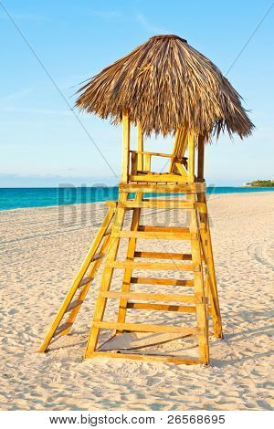 A lifesaver observation chair on a beautiful tropical beach near sunset