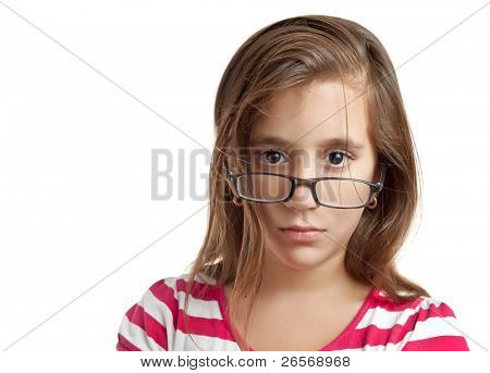 Beautiful latin girl with glasses looking seriously at the camera isolated on a white background