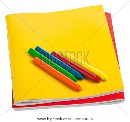 Colorful notebooks and color crayons isolated on a white background with clipping path