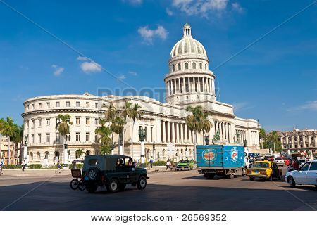 HAVANA-SEPTEMBER 12:Traffic in front of the Capitol September 12,2011 in Havana.Built in 1929 to house the island's Senate and House of Representatives,the Capitol dominates the skyline of Havana.