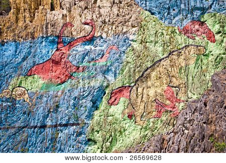 Detail of the Mural of Prehistory, a huge painting in the cliffs of the Vinales valley in Cuba