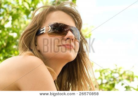 Young beautiful blonde girl in sunglasses, in her early twenties