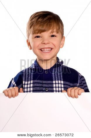 Funny little boy holding a blank white sign for your message. Good for borders of articles or websites. Isolated on white background.