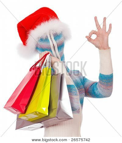Portrait of a girl in cardigan with a hood with no face. Santa with shopping bags.