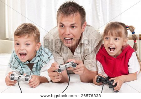 poster of Happy family - father and children playing a video game