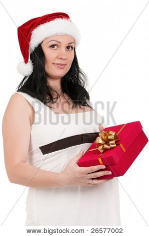 Portrait of a pregnant woman in santa hat with gift box over white background. Third trimester.