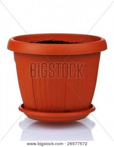Garden plastic pot with soil on a white background