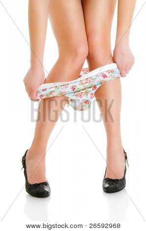 Woman takes off her panties. Isolated over white.