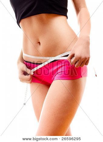 Woman measuring her body. Isolated over white