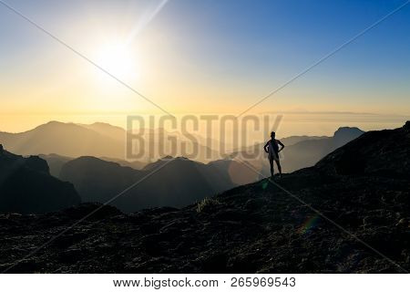 Woman Hiking Silhouette In Mountains