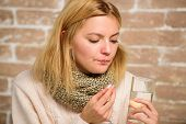 Headache And Fever Remedies. Woman Tousled Hair Scarf Hold Glass Water And Tablets Blister. Girl Fee poster