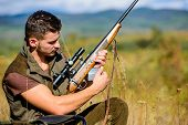 Hunting Equipment Concept. Hunter Khaki Clothes Ready To Hunt Nature Background. Hunting Shooting Tr poster