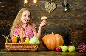 Harvest Festival Concept. Child Girl Presenting Harvest Of Her Vegetable Garden On Wooden Background poster