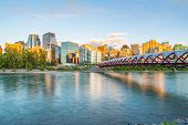 Skyline Of The City Calgary, Alberta, Canada Along The Bow River With Peace Bridge poster