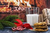 Milk And Homemade Chocolate Chips And Cranberrry Cookies For Santa. Traditional Snack For Santa Clau poster
