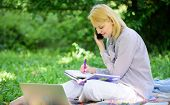 Woman With Laptop And Smartphone Working Outdoors. Girl Use Modern Technology For Business. Use Oppo poster