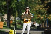 Young Shocked Traveler Tourist Woman In Yellow Summer Casual Clothes Hat With Suitcase City Map Walk poster