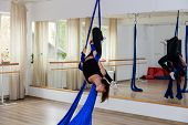 Young Gymnast Woman Doing Gymnastics On Rope In Aerial Gymnast Training With Safety Ropes poster