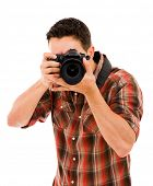 Young photographer with camera, isolated on white