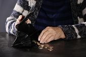 Poor Elderly Woman Counting Coins At Table, Closeup poster