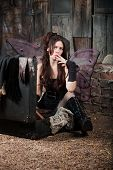 pic of faerie  - Faery girl sitting on ground smokes cigar - JPG