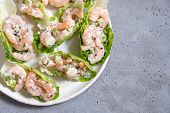 Shrimp Salad Wraps In Lettuce Leaves On A Holiday Table poster