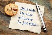 Do not wait. The time will never be just right. - handwriting on a napkin poster