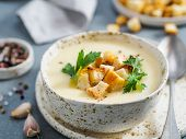 Cauliflower Potato Soup Puree On Stone Background, Creamy Cauliflower Soup With Toasted Bread Crouto poster