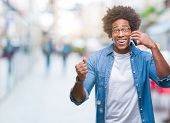Afro american man talking on the phone over isolated background very happy and excited, winner expre poster