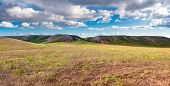Panorama Hills In Sunny Day. Vista Scenic Idylic Landscape Hills Sun Through The Clouds Meadow poster