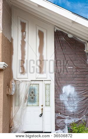 A home repaint project shows the detailed preparation and masking required to do the job properly.