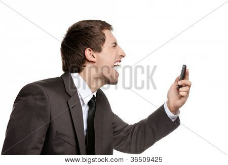 Angry business man screaming on cell mobile phone, concept of executive yelling, conversation problem and communication crisis, isolated on white