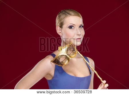 Attractive girl with masquerade masque, isolated on purple