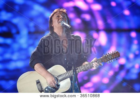 MOSCOW - DEC 17: Chris Norman from the group Smokie sings on scene during concert of Legend RetroFM in Sports complex Olimpiyskiy, Dec 17, 2011 in Moscow, Russia. C.Norman is member of group Smokey.