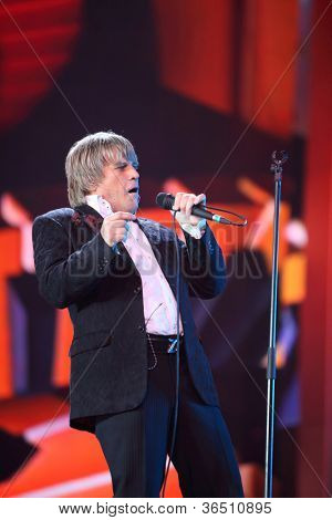 MOSCOW - DEC 17: Aleksey Glizin sings on scene during concert of Legend RetroFM in Sports complex Olimpiyskiy, on Dec 17, 2011 in Moscow, Russia. In 1989, A.Glizin made group and name she Cheers.