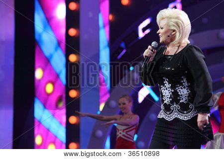 MOSCOW - DEC 17: Anne Veski sings on scene during concert of Legend RetroFM in Sports complex Olimpiyskiy, on Dec 17, 2011 in Moscow, Russia. A.Veski born in Rapla, Estonian SSR, 27 February 1956.