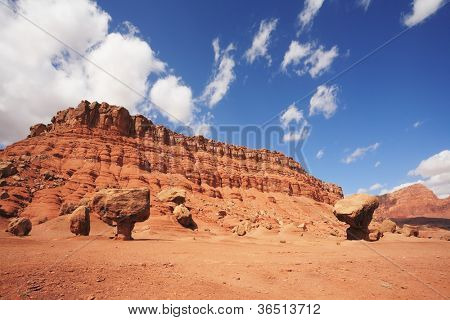 "Magnificent American red desert. Huge ""mushroom"" from red sandstone. Solar midday sun"