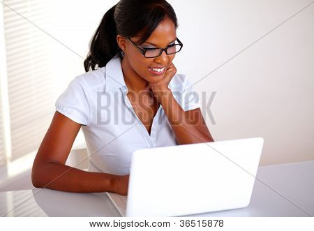 Charming Young Black Woman Working On Laptop