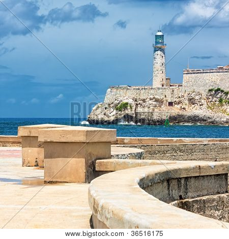 The castle of El Morro, a symbol of Havana, with the famous promenade known as El Malecon