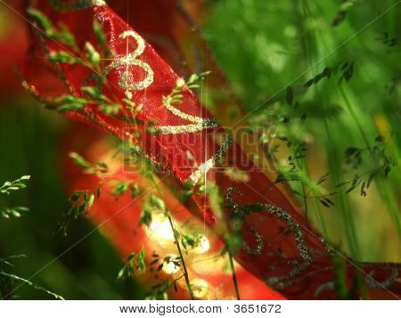 Sparkling Red Ribbon And Greens