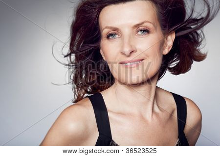 Attractive happy middle-aged woman with curly hair.