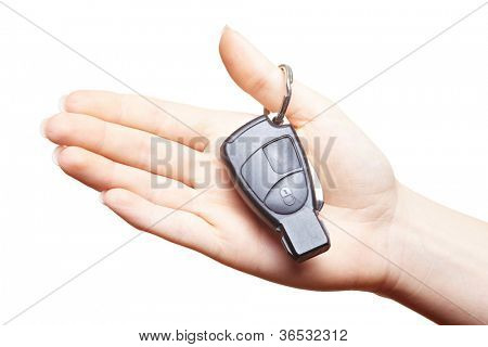 Female hand holding car keys in the palm