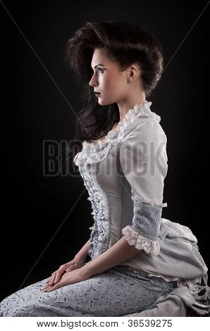 portrait of vampire woman aristocrat with stage makeup isolated on black