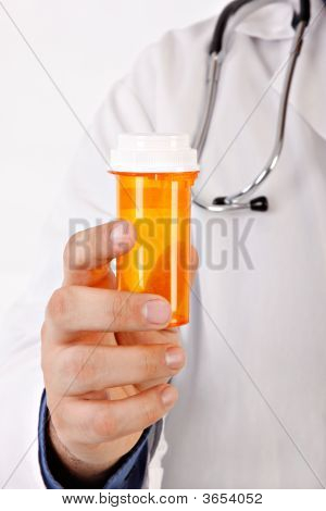 Doctor Hand Holding Medicine Bottle