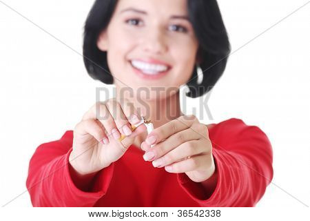 Young woman with broken cigarette. Stop smoking concept.
