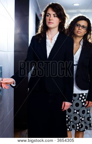 Young Businesswomen At Office Corridor
