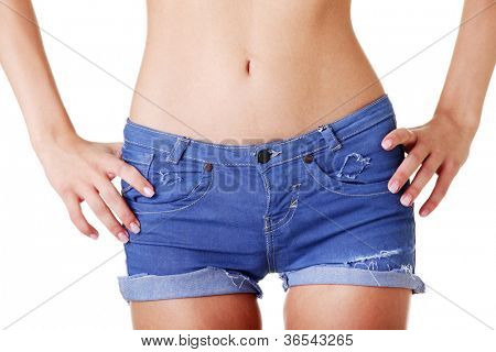 Fit woman in jeans shorts