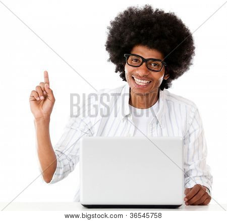 Geek with a laptop pointing an idea - isolated over a white background