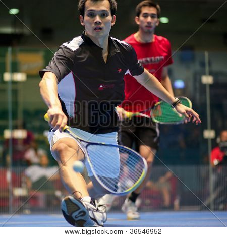 KUALA LUMPUR - SEPTEMBER 01: Ong Beng Hee (black) takes on Kamran Khan (red) at the TC Malaysian National Squash Championships 2012 played at the Arena Nicol David, Malaysia on September 01, 2012.
