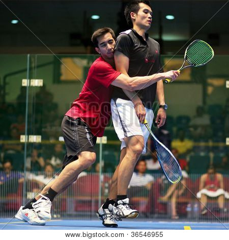 KUALA LUMPUR - SEPTEMBER 01: Kamran Khan (red) takes on Ong Beng Hee (black) at the TC Malaysian National Squash Championships 2012 played at the Arena Nicol David, Malaysia on September 01, 2012.